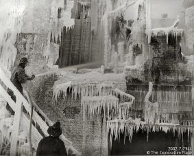 Photo of firefighters working to subdue flames inside the shell of the ice-covered Ritts-Kifer Hall, January 1957.