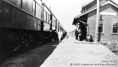 Photo of people receiving mail off a train stopped in Valemount, British Columbia