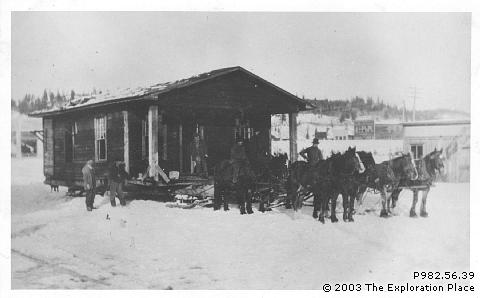 Photo of a house being moved by horses from Central Fort George to Prince George, 1910s.