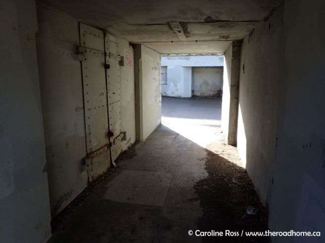 The corridor linking the east and west parts of the battery allowed soldiers to move quickly from the plotting room (behind the barred doors) to either set of guns. Photo: Caroline Ross / The Road Home