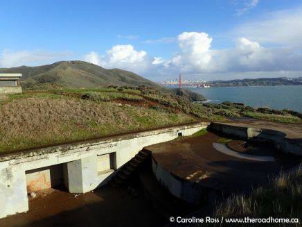 The view southeast from Battery Rathbone-McIndoe, with San Francisco and the Golden Gate Bridge in the distance and a circular gun mount in the right foreground. Photo: Caroline Ross / The Road Home