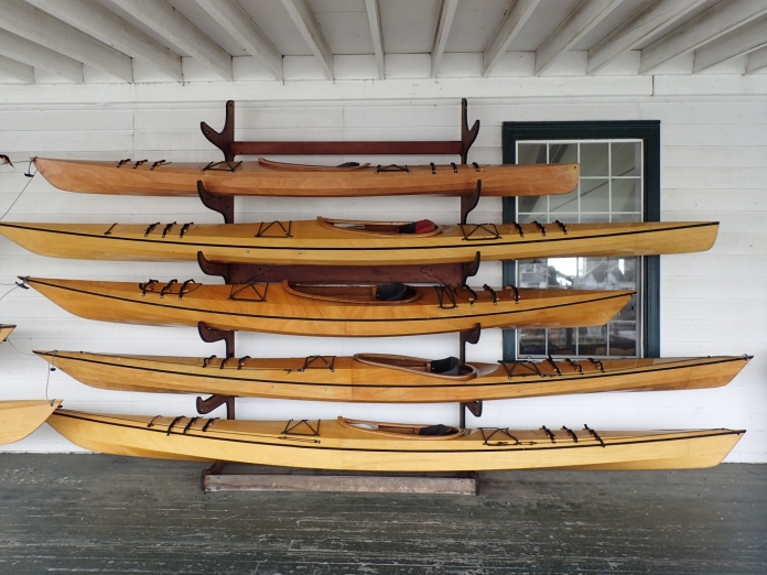 One of several display racks on Pygmy Boats' open front porch.