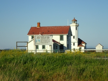 The 1897 lightkeeper's residence (foreground) and 1914 light station (behind, visible to the right) at Point Wilson.