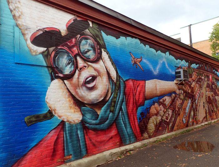 Photo of soaring aviator child mural in the Glebe neighbourhood, Ottawa.