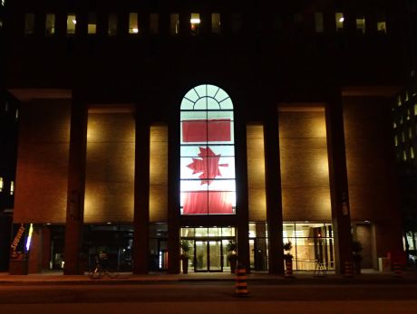 Photo of a Peace Tower flag on display in a downtown Ottawa building.