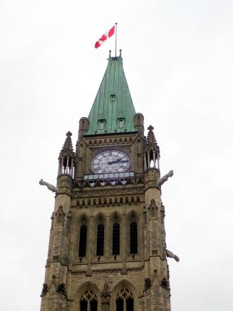 Photo of Peace Tower with gargoyles protruding.