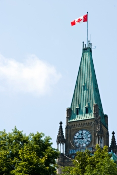 Photo of Peace Tower flag and clock.
