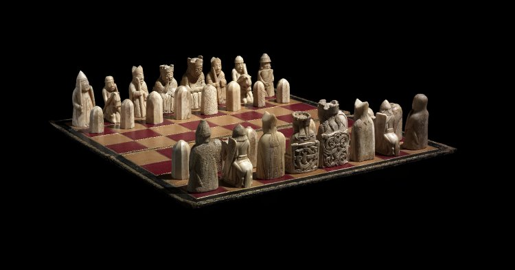 Photo of Lewis chessmen on a chess board.