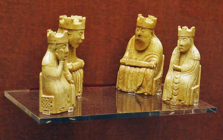 Photo of two kings and two queens from the Lewis chess set.